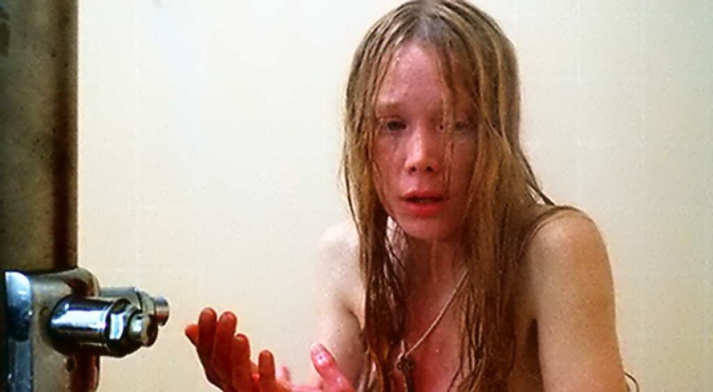 Carrie suddenly realizes something is terribly wrong while showering in the locker room.
